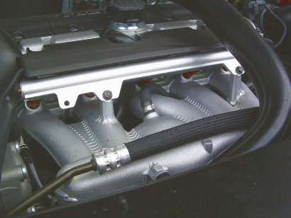 This die-cast aluminum manifold feeds the five-cylinder engine through short runners off of the plenum.