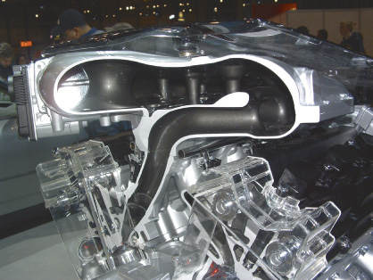 In a port fuel injection engine, the intake manifold delivers air to the intake ports.
