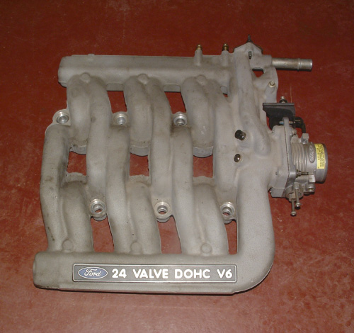This manifold provides a short and a long runner for each cylinder. Both are opened at higher engine rpms to improve engine breathing.