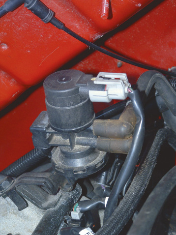 This vacuum solenoid is controlled by the PCM and uses the pull of vacuum to draw fuel vapors into the intake manifold.